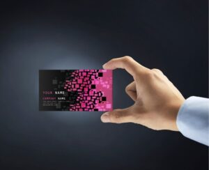 hand holding up business card