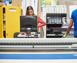 people working in a printing shop